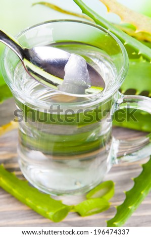 Herbal medicine: Beverage with Aloe vera juice - stock photo