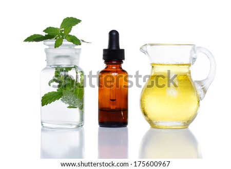 Herbal medicine dropper bottle with mint water with oil - stock photo