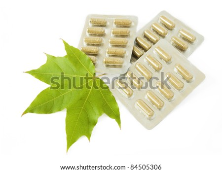 Herbal medicine in blisters isolated on white background - stock photo