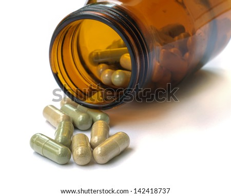 Herbal medicine in medical bottle. - stock photo