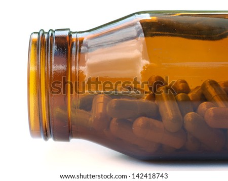 Herbal medicine in medical bottle. - stock photo
