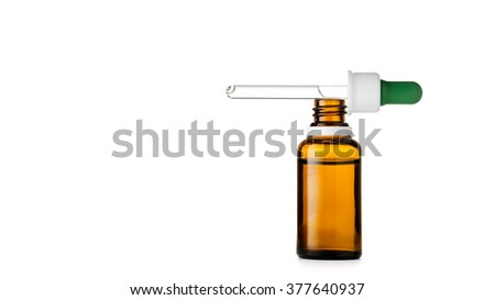 Herbal medicine or aromatherapy dropper bottle isolated on white background with clipping path - stock photo