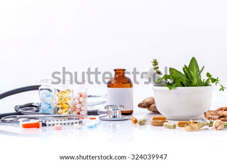 Herbal medicine VS Chemical medicine the alternative healthy care with stethoscope isolated on white background. - stock photo