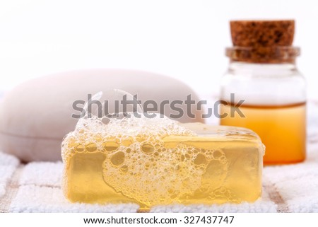 Herbal spa soap bar on white bath towel with honey isolate on white background. - stock photo