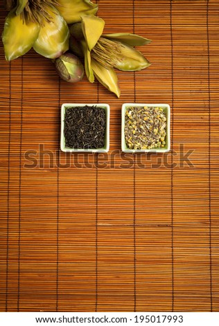 Herbal tea, green tea,  on straw background. Space below for inscription. - stock photo