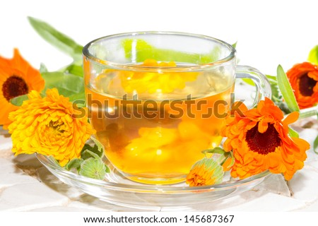 Herbal tea made from Calendula officinalus, or the Pot Marigold, with fresh orange flowers used as a colourant in cookery and as a bactericide, anti-inflammatory and antiviral treatment in naturopathy - stock photo
