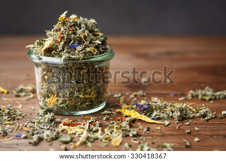 Herbal tea mixture in a glass bowl - stock photo