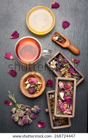 herbal tea with honey and dried herbs and flowers. top view - stock photo