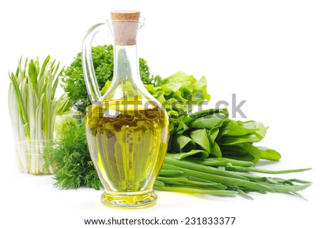 herbs and oil over white - stock photo