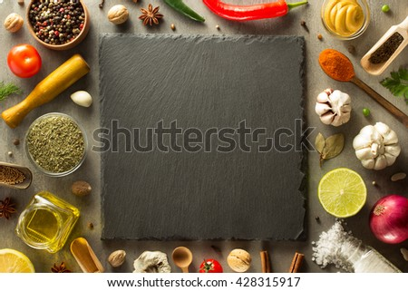herbs and spices at stone table background - stock photo