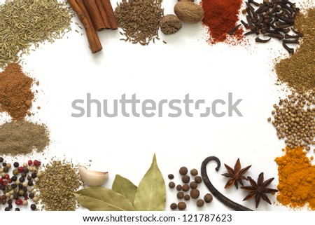 Herbs and spices border on white background - stock photo