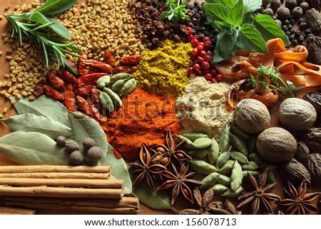 Herbs and spices composition. Cooking ingredients on a ceramic tabletop. - stock photo