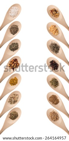 Herbs and spices on a wood spoon. Isolated, room for copy space. - stock photo