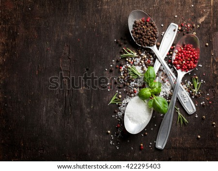 Herbs and spices on wooden table. Top view with copy space - stock photo
