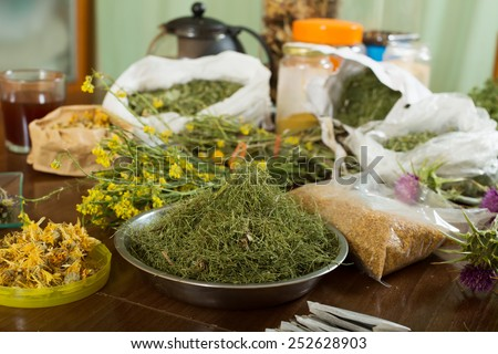 herbs at table in home  for brews - stock photo