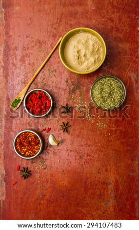 Herbs for cooked with herbs on the red old wooden background. - stock photo