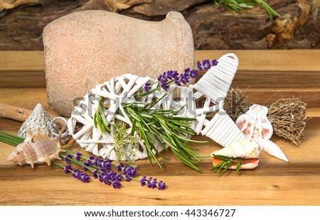 Herbs for fish dishes decorated on a wooden table. - stock photo