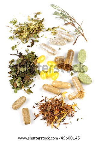 Herbs,  herbal supplements and vitamin pills on white background - stock photo