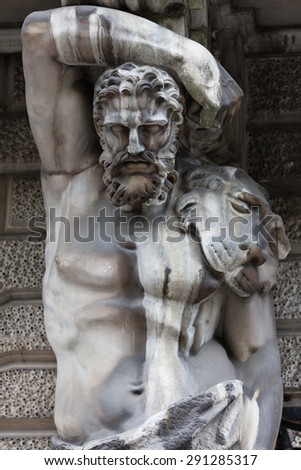 Hercules. Detail of the facade decoration mansion XVIII century. Influence of weather conditions on the architecture of St. Petersburg, Russia - stock photo