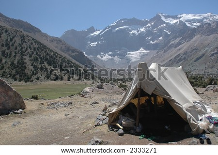 Herder's tent in mountains near pastures. Tajikistan. - stock photo