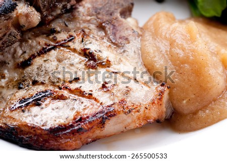 heritage cut organic pork chops with home made applesauce - stock photo