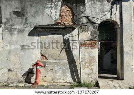 Heritage House. Dilapidated building. Crumbling plaster revealing victorian brickwork underneath. Symbol of urban decay.  - stock photo