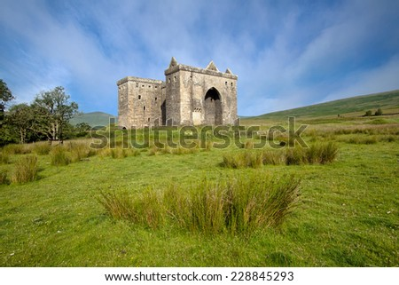 Hermitage Castle, Liddesdale Valley, County Roxburghshire, in the Scottish Borders is a ruined stronghold built by the Douglas family around 1360 and with historic connections to Mary Queen of Scots. - stock photo