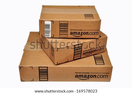 HERNDON, VA, USA - JULY 17, 2012: Three sealed Amazon.com packages stacked on top of each other and isolated on a white background. - stock photo