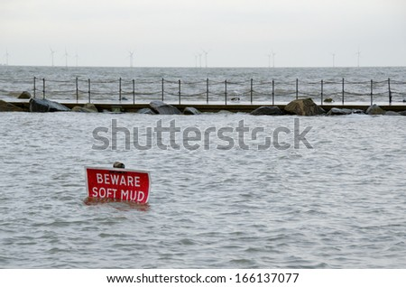 HERNE BAY, KENT, UK - DEC 6:  Sea defences hold firm despite very high water levels caused by a spring tide combined with a storm surge at The Harbour, Herne Bay, Kent, UK on Dec 6, 2013.   - stock photo