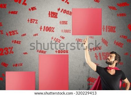 Hero businessman raises a step of statistic - stock photo