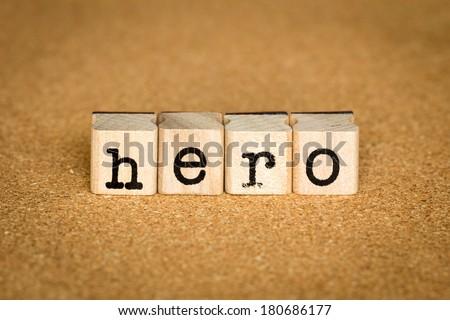 Hero Concept, Alphabet stamp on a cork board - stock photo