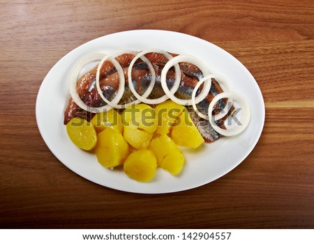 herring fish fillets with potato and onion - stock photo