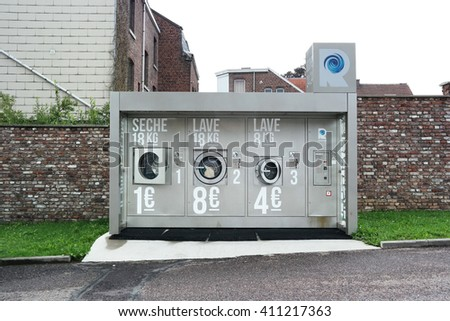 HERVE, BELGIUM - JULY 2015: Laveries Revolution, commercial washing machines and dryer in a self-service laundry. Explored by Kis, Photomaton Photo taken on July 30, 2015 in Herve, Belgium - stock photo