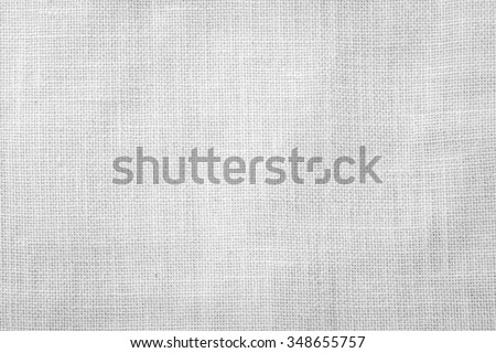 Hessian sackcloth woven texture pattern background in bleached white grey color tone: Eco friendly raw organic flax cloth fabric textile backdrop: Bag rope thread detailed textured burlap canvas  - stock photo