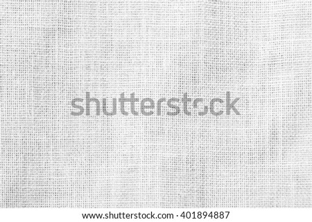 Hessian sackcloth woven texture pattern background in bleached white grey gray color tone: Eco friendly raw organic flax cloth fabric textile backdrop: Bag rope thread detailed textured burlap canvas - stock photo
