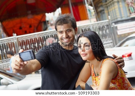 Heterosexual couple travelling in asia country, and trio on the asian city - stock photo