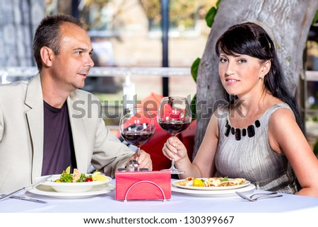 Heterosexual middle aged couple in a cafe - stock photo
