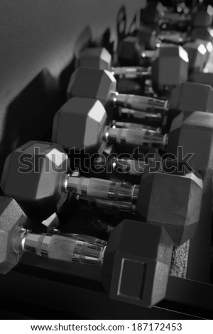 Hex Dumbbells weight training equipment at gym - stock photo