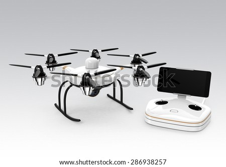 Hexacopter and remote controller isolated on gray background. RC controller docking with smartphone. Clipping path available. - stock photo