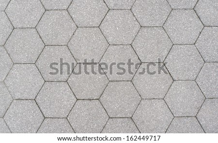Hexagon pattern cement sidewalk                              - stock photo