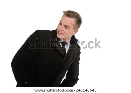 Hey guys are you coming with me? I will show you the right way to successful business. Portrait of a young businessman looking over his shoulder. - stock photo