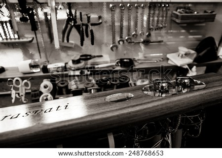 Hi fi amplifier with electronic vacuum tubes devices. Wood chassis . Laboratory background with tools line pliers and wrenches - stock photo
