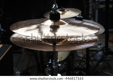 hi-hat on stage, combination cymbal in a percussion drum kit for pop, rock, jazz, folk music and more, dark ambient, selected focus, narrow depth of field - stock photo