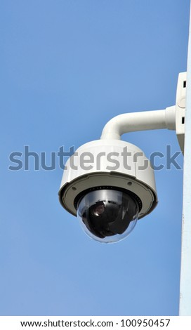 Hi-tech dome type camera on a wall - stock photo