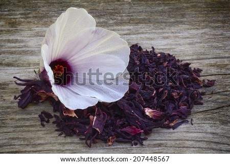 Hibiscus tea (Hibiscus sabdariffa) also known as Karkadè or Roselle. Flower and sepals dried for infusions - stock photo