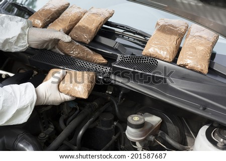 Hidden drugs in a vehicle compartment  - stock photo