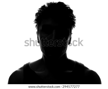 Hidden face in the shadow.male silhouette. - stock photo