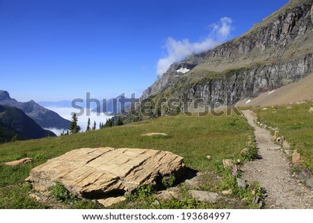 Hidden Lake Trail Above the Clouds, Glacier National Park - stock photo