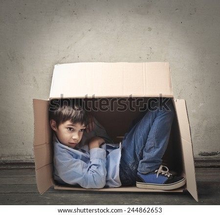 Hiding in the box  - stock photo