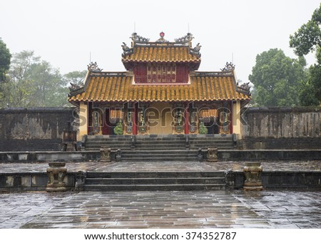 Hien Duc Gate at the Tomb of Minh Mang, Vietnam on a wet, rainy day. - stock photo